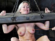 Dia Zerva is stocked in bondage and spanked by maledom in dungeon