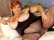 Fat redhead mature Miss T in pantyhose modelling and spreading pussy