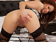 Miah Croft in lingerie and black stockings spreads on bed