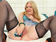 Lily May bigboobs mature blonde in black stockings strips