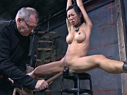 Tia Ling busty asian bound in chains her pussy toyed and spanked