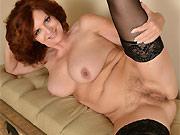 Andi James busty milf hottie poses in black stockings