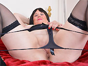 Bigboobs amateur mom in black stockings strips and toying