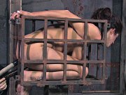 Lavender Rayne brunette bound in metal her ass with pussy toyed