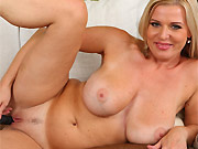 Angels Elis busty milf blonde strips and plays a pussy
