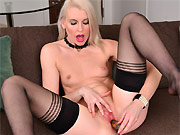 Lexi Lou long-legged blonde in stockings toying on sofa