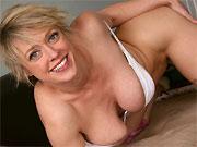 Dee Williams busty milf blonde shows a striptease