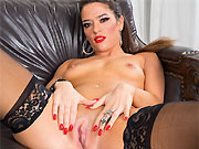 Victoria Voxxx in black stockings and boots poses in armchair