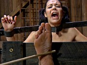 Beverly Hills busty brunette is bound in chains for spanking