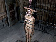 Rain DeGrey bound in metal for dipping and spanking in dungeon
