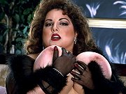 Busty fat mature brunette posing in black lingerie and showing pussy