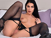 Roxy Mendez dark-haired hottie in stockings toying on bed