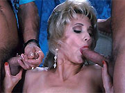 Two guys fuck horny blonde on a chair