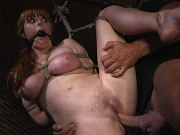 Moka Mora busty redhead is bound for anal and spanking by maledom