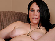 Summer Avery busty dark-haired milf stripping in armchair