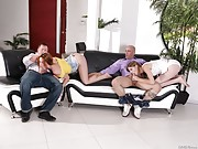 Two swinging couples have a foursome in the livingroom