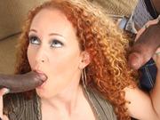 Redhead milf Kitty Caulfield in an interracial mmf