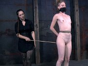 Renee Blaine in rope bondage is spanked by lezdom Sister Dee