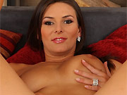Anita Queen busty beauty in red dress strips on a bed