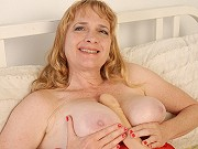 Naughty fat mature blonde Erica playing a massive dildo on couch