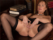 Karon Ross in black stockings plays pussy on a table