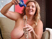 Fat mature Deedra Rae showing off her big boobs and playing a dildo
