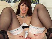 Toni Lace busty milf hottie poses in black stockings