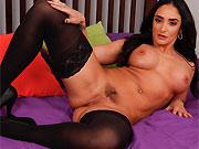 Sheena Ryder busty brunette poses in black stockings