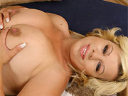 Silvy Vee sexy blonde with big natural boobs spreads on bed