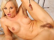 Sharka Blue sexy blonde in boots strips and plays pussy