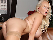 Angel Wicky sexy busty blonde poses in tan stockings
