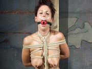 Lavender Rayne busty brunette is rope bound with nipples clamped
