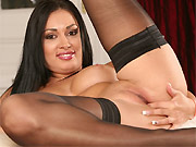 Sexy brunette Rosaline Love poses in black stockings