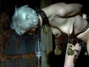 Cherry Torn blonde is metal toyed and clamped in bdsm dungeon
