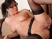 Horny brunette Michelle Hush poses in black stockings