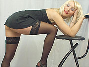 Lovely blonde lady teasing in stockings