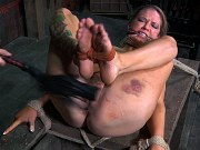 Rain Degrey busty struggles in metal bondage is toyed by lezdom