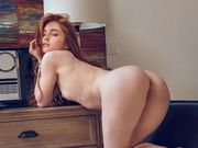 Redhead coed drops down red panties and plays with her pussy