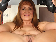Busty milf hottie Elexis Monroe strips and poses in armchair
