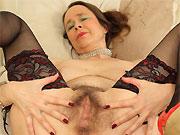 Busty hairy milf Josie Posie poses in black stockings
