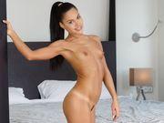 Sultry Latina posing naked in white knee high socks