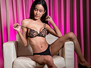 Ladyboy Nikki in a pink room fiercely strokes her huge cock