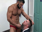 Guy in red speedos gets blown by this hunk wearing a business suit.