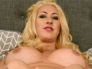 Busty milf blonde Janna Hicks posing nude on a bed