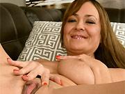 Busty milf hottie Elexis Monroe poses nude on a sofa