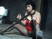 Nikki Nymph submissive in red with pantyhose is bound with clamps