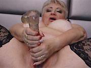 Horny milf Marta Bellefleur caresses shaved pussy on sofa