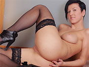 The young beauty Emylia Argan poses in black stockings