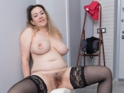 Nice brunette in black stockings fucks with two guys