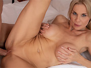 Busty milf blonde Nadya Basinger fucking on a bed